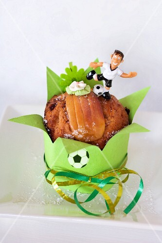 A sunken apple cake with football decorations