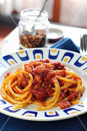 Bucatini all Amatriciana (pasta with pancetta, tomatoes and chilli sauce, Italy)
