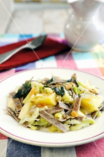Pizzocheri della Valtellina (buckwheat pasta, Italy) with cheese, cabbage, potatoes and sage butter