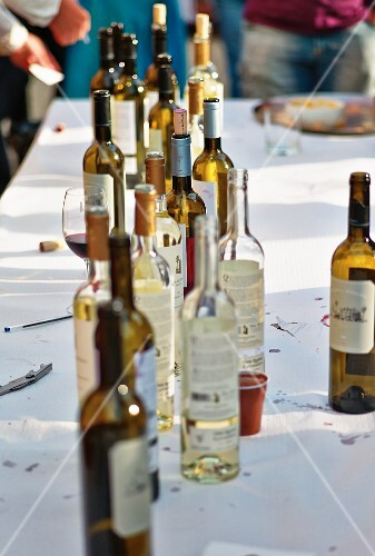 Empty wine bottles on a cleared table (Portugal)