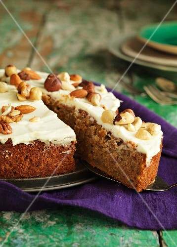 Carrot cake with lemon and nuts, sliced