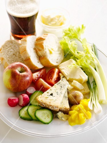 A ploughmans lunch with a glass of beer (England)