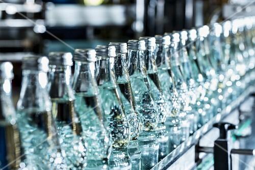 Lots of mineral water bottles on a conveyor belt