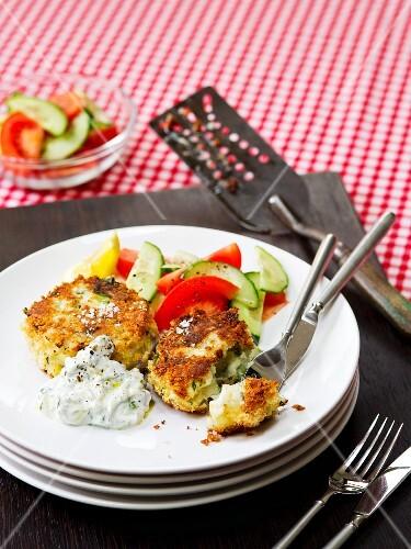 Smoked haddock fish cakes with a vegetable salad and tzatziki