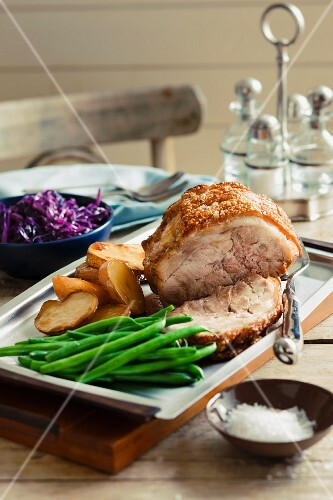 Roast pork with green beans, potatoes and red cabbage