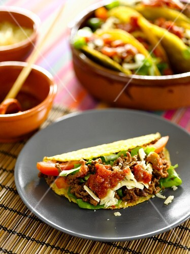 Tacos with minced meat and tomatoes