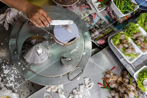 A traditional dessert being made at a market in Phuket, Thailand
