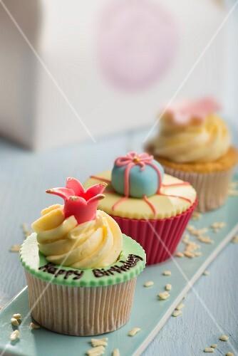 Three decorated cupcakes