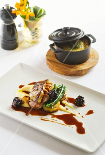 Duck with blackberries and goose liver