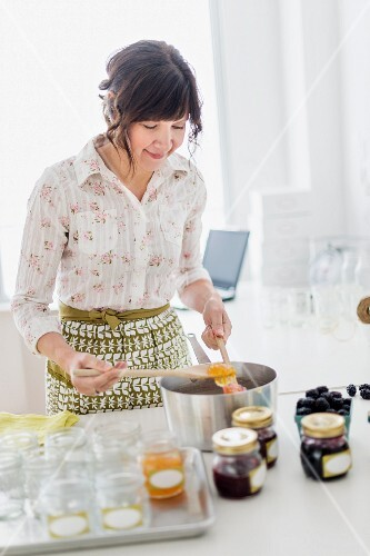 A woman making jam