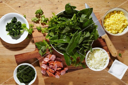 Ingredients for Heggenmös (stew made with wild herbs, green kale and sausages)