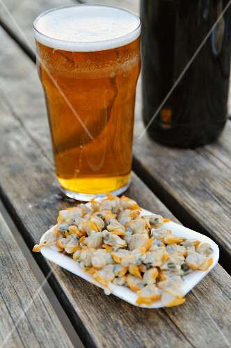 Mussels and beer on a wooden table