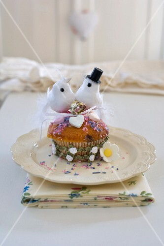 A cupcake with wedding decoration