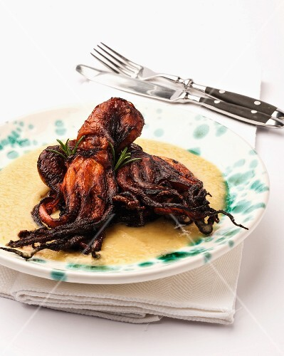 Fried octopus on a bed of creamy polenta