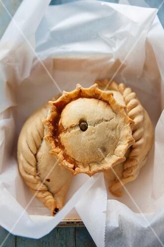 Empanadas on a piece of paper in a bread basket (Brazil)