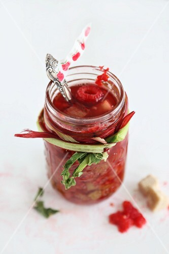 A jar of rhubarb and raspberry compote