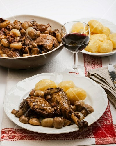 Coq au vin with mushrooms and new potatoes