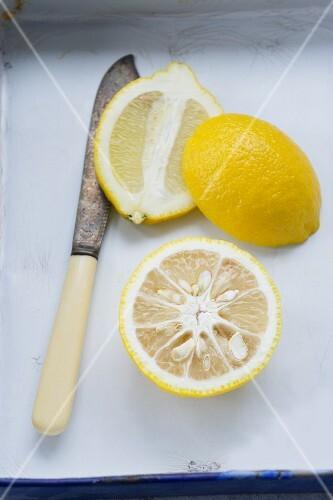 Half a yuzu and a halved lemon