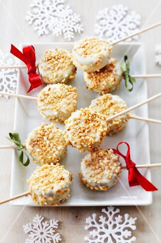 Christmas cake pops decorated with white cooking chocolate and nut brittle