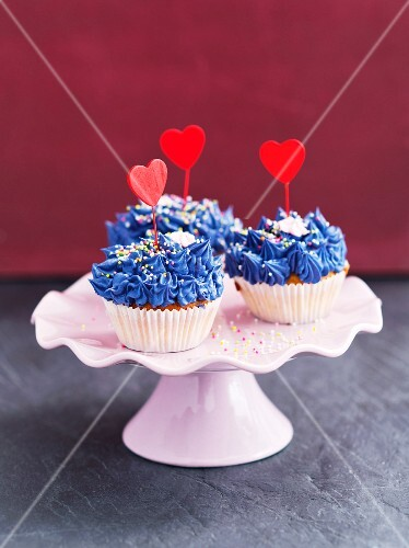 Cupcakes decorated with blue buttercream and hearts