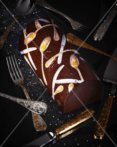 A chocolate Swiss roll with cutlery