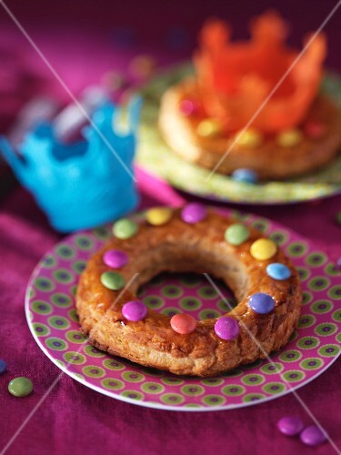Galette Des Rois decorated with coloured chocolate beans and nougat cream (France)