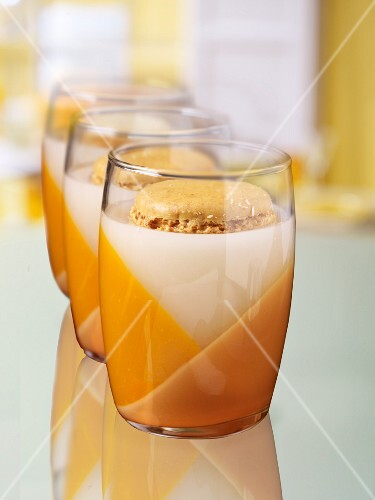 A macaroon in a glass of milk