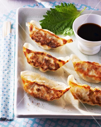 Gyoza (Japanese pastry parcels) with soy sauce