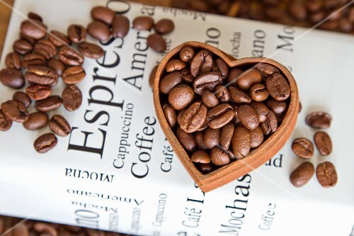 Coffe beans in a heart-shaped bowl