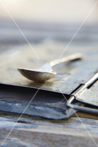 A metal spoon on a slate platter