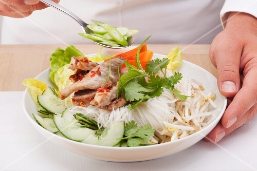 Vietnames rice noodle salad being served