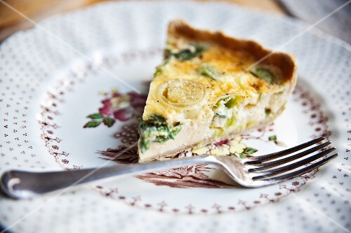 A slice of cheddar and leek quiche