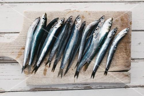 Fresh anchovies on a chopping board