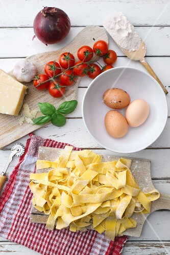 Homemade tagliatelle with ingredients for tomato sauce