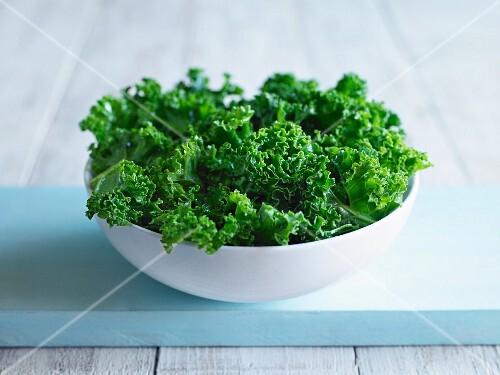 Green kale in a white bowl