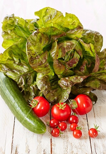A lettuce with cucumber and tomatoes