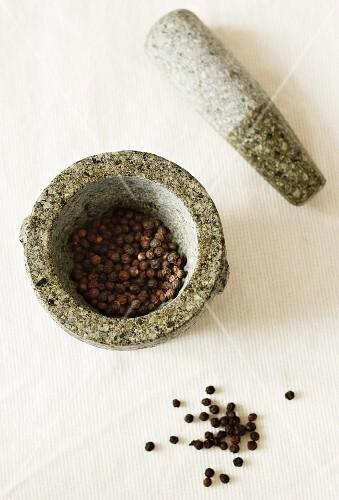 Peppercorns in a mortar
