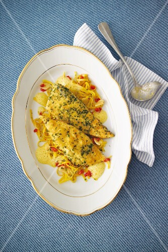 Plaice fillets with a braised pepper sauce and garlic pasta