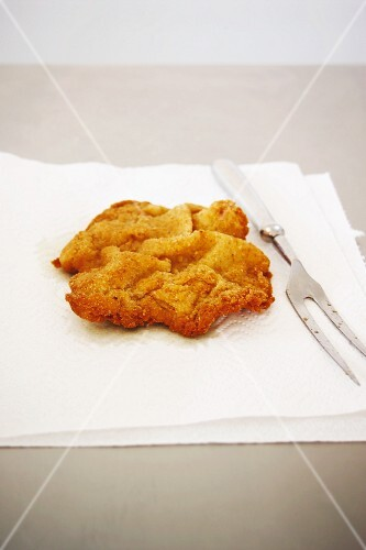 A Vienese escalope on a piece of baking paper