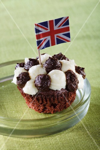 A cupcake decorated with the Union Jack flag