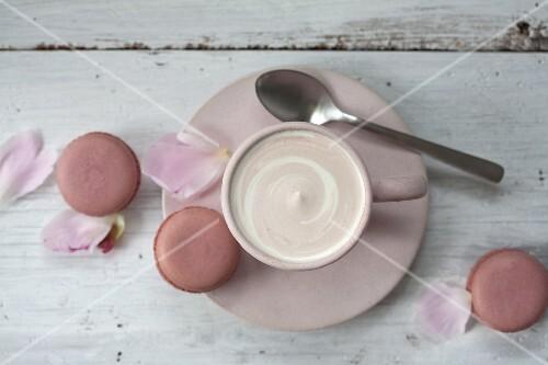 Hot chocolate, macaroons and peony petals