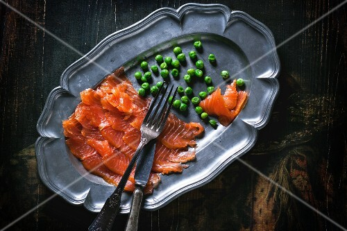 Smoked salmon and peas on a serving platter