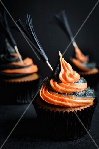 Halloween cupcakes decorated with witches broom sticks