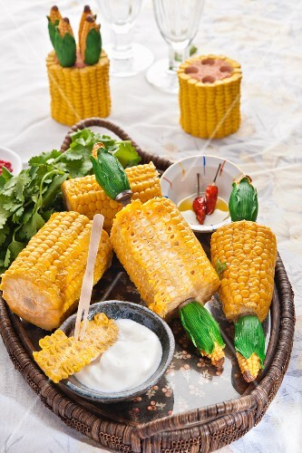 Sweetcorn cobs with sour cream and olive oil