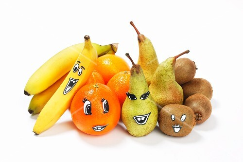 Various different fruits with faces