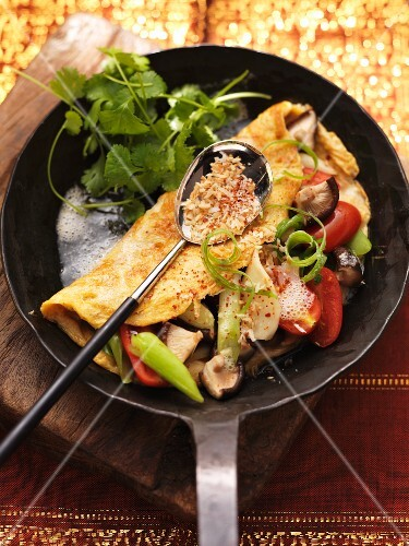 Stuffed chilli omelet with coriander (India)