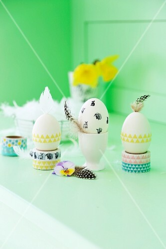 Easter arrangement; eggs decorated with washi tape, feathers and spring flowers