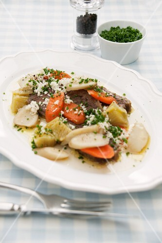 Prime boiled beef with grated horseradish, chives and vegetables