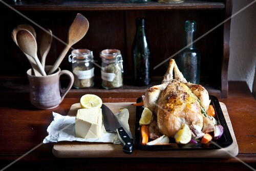 Roast chicken with root vegetables, butter and herbs