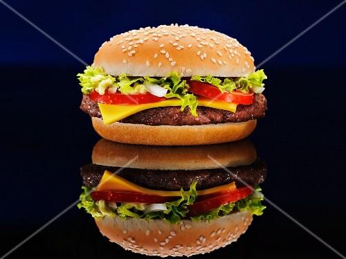 A cheeseburger and its reflection